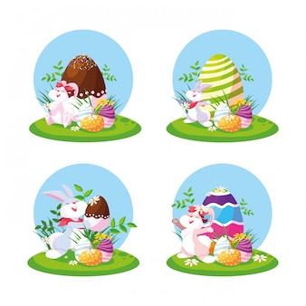 Grupowi króliki z jajkami easter w ogródzie
