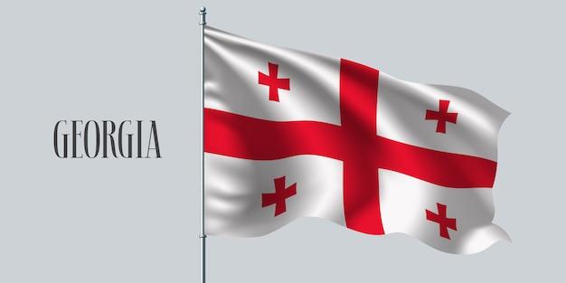 Gruzja macha flagą na maszcie