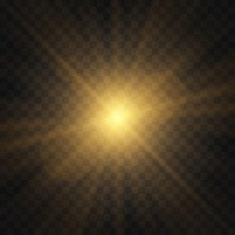 Gwiazda wybuchła iskierkami. zestaw żółtego świecącego światła wybucha na przezroczystym tle lśniące magiczne cząsteczki kurzu. złoty brokat bright star. przezroczyste świecące słońce, jasny błysk