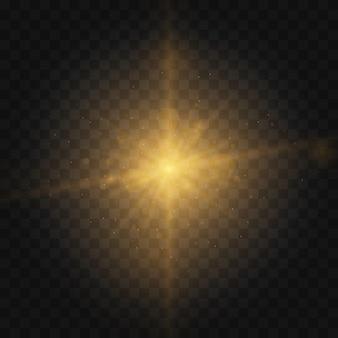 Gwiazda wybuchła iskierkami. zestaw żółtego świecącego światła wybucha na przezroczystym tle musujące magiczne cząsteczki kurzu. złoty brokat bright star. przezroczyste świecące słońce, jasny błysk