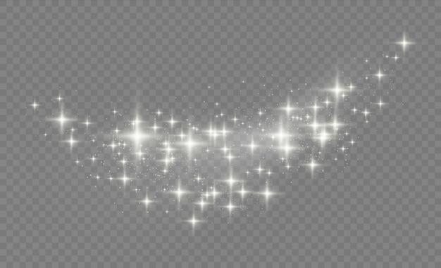 Gwiezdny pył iskrzy podczas eksplozji. białe iskry błyszczą specjalnym efektem świetlnym. lśniące magiczne cząsteczki kurzu.