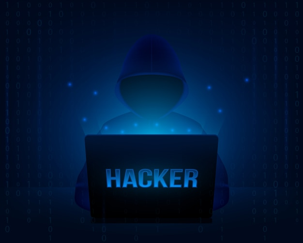 Hacker z kapturem w laptopie.