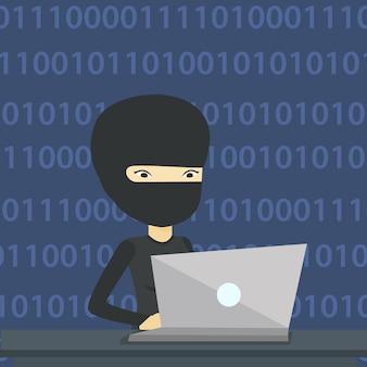 Haker używa laptopa do kradzieży informacji.