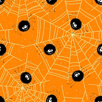 Halloween bezszwowe tło z pająkami i web