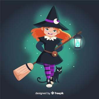 Halloweenowa czarownica i czarny kot