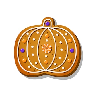 Halloweenowe pierniczki w kształcie słodkiej dyni z lukrem na białym tle t...