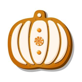 Halloweenowe pierniczki w kształcie słodkiej dyni z polewą i cukierkiem na białym tle...