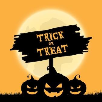 Halloweenowe sztuczki lub psikusy w tle z upiornymi lampionami jack o