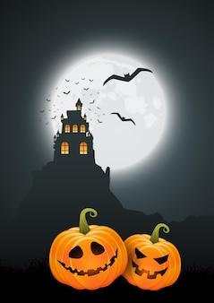 Halloweenowe tło z dyniami i upiornym projektem krajobrazu zamku