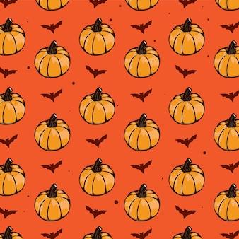 Halloweenowy bezszwowy wzór pumkins i nietoperz