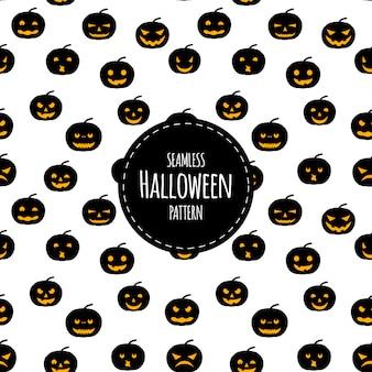 Halloweenowy bezszwowy wzór z baniami. styl kreskówkowy.