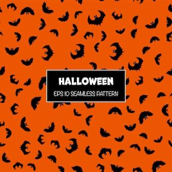 Halloweenowy bezszwowy wzór z nietoperz sylwetkami. styl kreskówkowy.