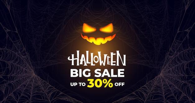 Halloweenowy duży baner sprzedaży. świecąca dynia. premium.