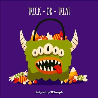 Halloweenowy kosz potworów pełen cukierków i słodyczy