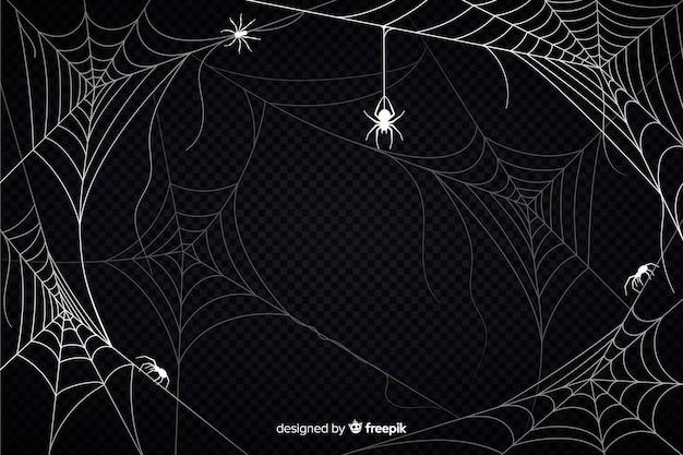 Halloweenowy pajęczyny tło z pająkami