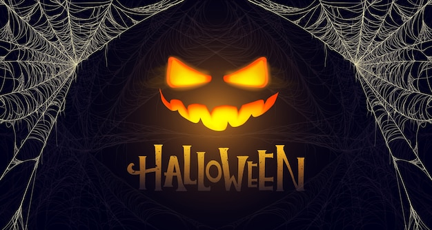 Halloweenowy sztandar ze świecącą dynią i pajęczyną. premium.