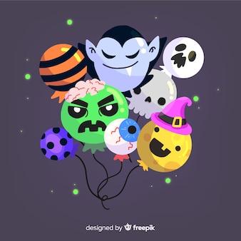 Halloweenowy tło z różnorodnymi balonami