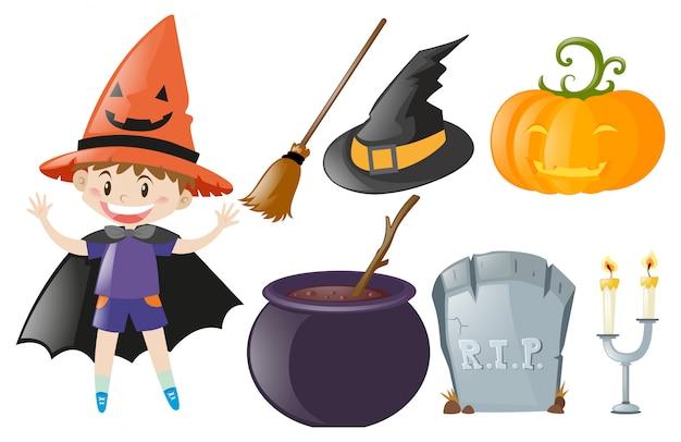 Halloweenowy temat z chłopiec i czarownicy kostiumem