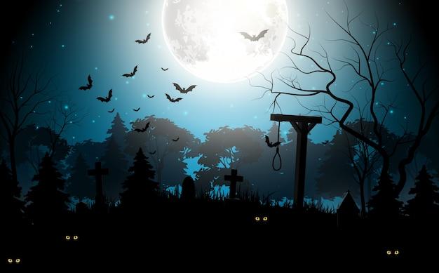 Halloweenowy tematu tło przy nawiedzającym cmentarzem