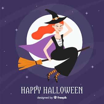 Halloweenowy tło z ładną czarownicą