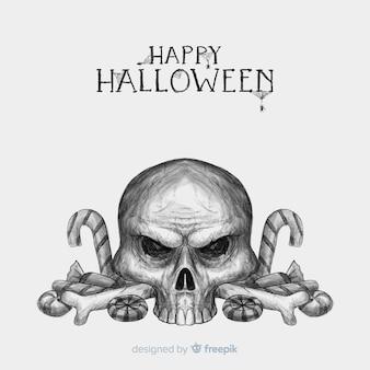 Halloweenowy tło z ręka rysującą czaszką