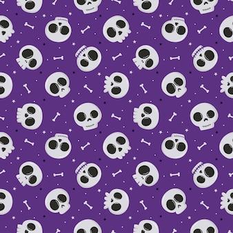 Halloweenowy wzór z czaszką i kością na białym tle na fioletowym tle