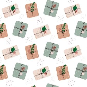 Handdrawn bezszwowy wzór z prezentami świątecznymi boże narodzenie wzór z prezentami