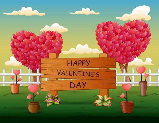 Happy valentines day znak z drzewami serca w parku