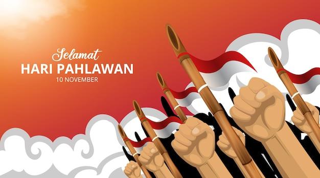 Hari pahlawan lub tło dnia bohaterów indonezji z pięścią i wyostrzoną bambusową ilustracją