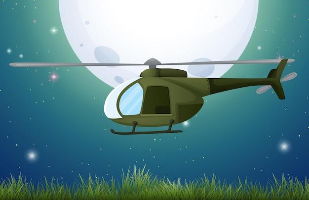 Helikopter lecący nad polem