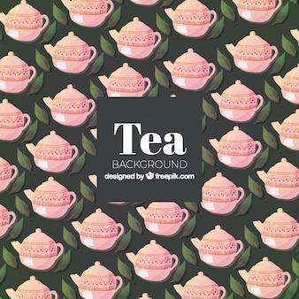 Herbata tło z liści i czajniki