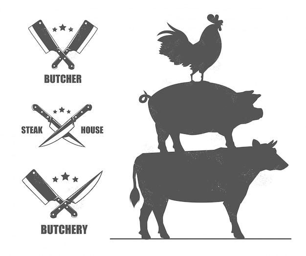Herby sklepu rzeźniczego z nożami i toporami. z kogutem, świnią i krową.
