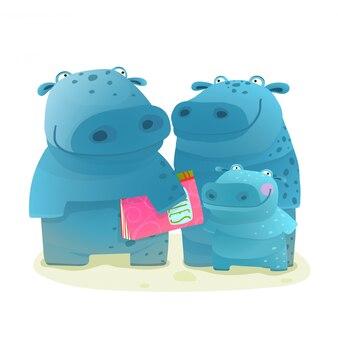 Hipopotam rodzina matka ojciec i dziecko z książką