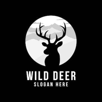 Hipster logo krajobraz dzikiego jelenia