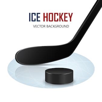 Hokejowy kij i krążek na lodowisku.