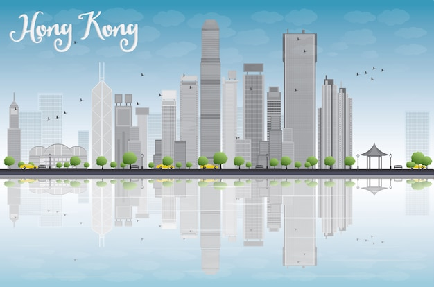 Hong kong linia horyzontu z szarymi budynkami i niebieskim niebem.