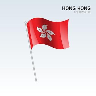 Hong kong macha flagą na białym tle na szarym tle
