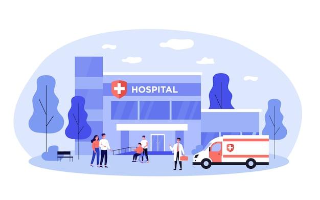 Hospitalizowani pacjenci i lekarze w pobliżu szpitala