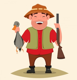 Hunter trzyma karabin i zastrzelił kaczkę.