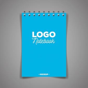 Identyfikacja wizualna firmy, z notesem w kolorze niebieskim