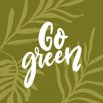 Idź zielony sztandar. ręka tekst skryptu napis na tle zielonych liści. koncepcja przyjazna dla środowiska.
