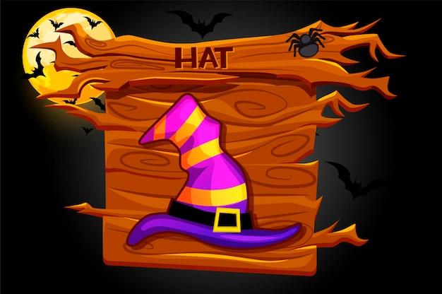 Ikona gry kapelusz, drewniana tablica halloween w nocy.