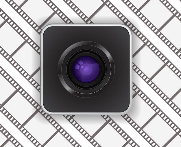 Ikona obiektywu aparatu fotograficznego na tle taśmy filmowej
