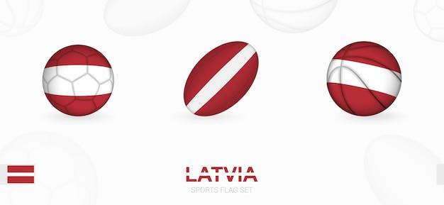 Ikony sportowe do piłki nożnej, rugby i koszykówki z flagą łotwy.