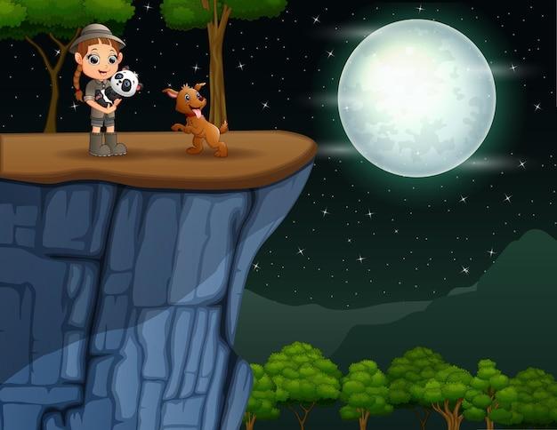 Ilustracja dziewczyny zookeeper i zwierząt na klifie