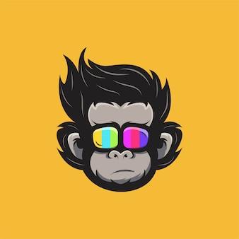 Ilustracja głowy małpy w kolorowych okularach.