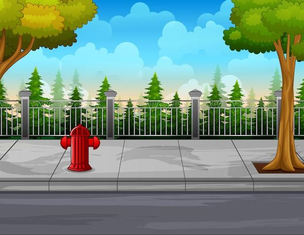 Ilustracja hydrantu przeciwpożarowego i drzew na poboczu drogi