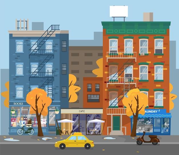 Ilustracja jesień pejzaż. deszczowa pogoda w mieście. pralnia, kawiarnia i księgarnie, taksówki, skutery. żółte drzewa. płaski styl.