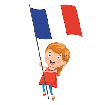 Ilustracja kid gospodarstwa flagą francji