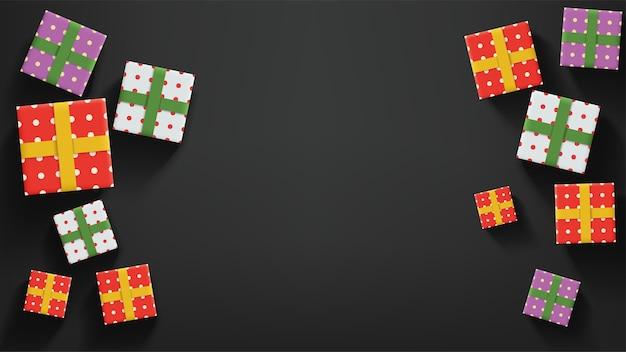 Ilustracja kolorowe prezenty świąteczne leżące na ciemnym tle z realistycznym cieniem